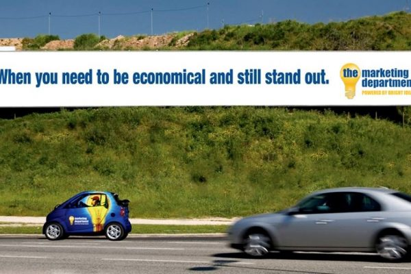 Billboard with small car